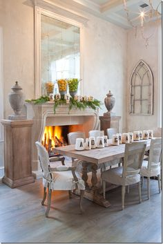 Pedestals flanking  fireplace - looove the table and chairs, too!