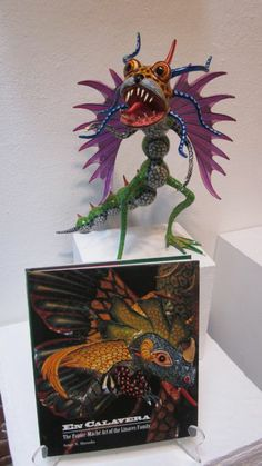 Paper mache alebrije by Mexico City master Joel Garcia accompanied by a book on the Linares family of paper mache artists (Garcia studied with them)
