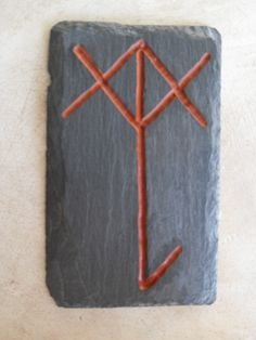 Bindrune for Protection. Reclaimed roofing slate hand carved and cold pressed Red Ocher oil paint.