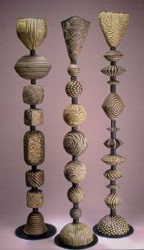 this would be a neat idea made of clay for tall pillars with a votive or tea light set in the top.