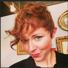Pixie with curly bang. .like it,  but would add a under cut!