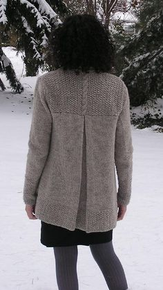 "This cardigan features long, lean lines, and a dramatic center-back pleat. The body is worked in one piece from bottom up to the armholes. The pleat is knitted in and bound-off. Separate pieces are worked for the back yoke, collar, and sleeves. The sleeves are knit in the round and sewn into the armhole.Finished Sizes: XS (S, M, L, XL, XXL) 33 (35, 37, 41, 46, 49)"" bust with cardigan held closed (two sides of shawl collar held touching each other, but not overlapping). The measurements are…"