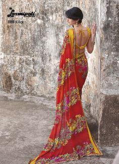 Red Georgette Saree + satin with  Printed Lace Makes A Colorful Combination, Brilliant  floral prints through out this saree. Just Superb...