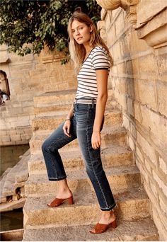 madewell retro crop bootcut jeans worn with the recycled cotton ringer tee + greer mule sandal.