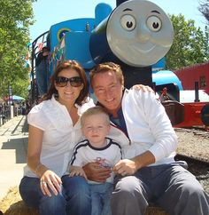 Family man: Flatley with his wife Niamh and their Thomas The Tank Engine-fanatic son Michael