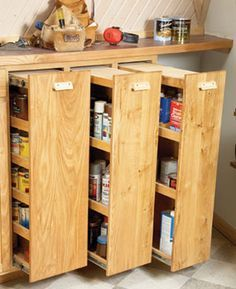 Pantry rollouts. WAY better use of space than a traditional store cupboard at home. Accessible too! Would be great for all the canning