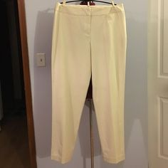 "J Jill Ivory Straight Leg Chino Pants size 18 Tall Up for grabs is this pair of chino dress pants from J. Jill. They are a size 18 tall with a 34"" inseam, a 40"" waist and 48"" hips. These pants are a straight leg style with a flat panel front. They a light ivory color with a wide waist with small slit pockets on the front hips. These slacks are new with the original tag. J. Jill Pants Straight Leg"