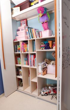 Designed the interior #shelving using #marine ply for strength, painted the back #wall #light blue for interest and had peg holes made for rejigging when needed.