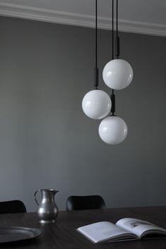 New lighting from Nuura - dark interiors - minimalist pendant light