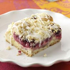 Lemon-Raspberry Streusel Cake Recipe from Taste of Home -- shared by Jeanne Holt of Saint Paul, Minnesota. Buttery almond streusel tops the luscious, raspberry-studded lemon cream in these very special bars. Lemon Recipes, Cake Recipes, Dessert Recipes, Dessert Ideas, Bread Recipes, 100 Calories, Just Desserts, Delicious Desserts, Lemon Desserts