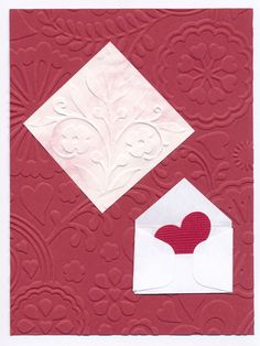 Cuttlebug embossing folders, tiny envelop punch by McGill, heart punch by Fiskars