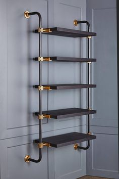 This single bay of our Loft Shelving is wall-mounted to support five shelves, using custom machined brass fittings on bent steel posts. Amuneal's proprietary machined hardware clamps onto the posts so that the shelves can be easily adjusted at any Loft Pipe Furniture, Industrial Furniture, Furniture Design, Industrial Lamps, Furniture Vintage, Furniture Stores, Vintage Industrial, Industrial Pipe Shelves, Copper Pipe Shelves