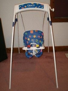 Wind-up baby swing - sure wouldn't be considered baby safe nowadays!!