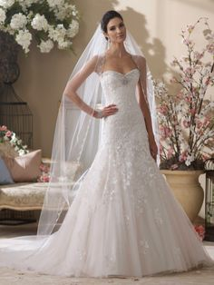 David Tutera for Mon Cheri - 214219 – Picabo -     Wedding Dresses 2014 Collection – Strapless lace appliqué, tulle and sequin over satin full A-line wedding dress, sweetheart neckline and curved back bodice adorned with hand-beaded jeweled trim, dropped waistline, lace appliqués accented with sequin cascade down to baby hemline and chapel length train, detachable spaghetti and halter straps included. The Berger Collection for Mon Cheri veil style 9534 sold separately. Embellish by David…