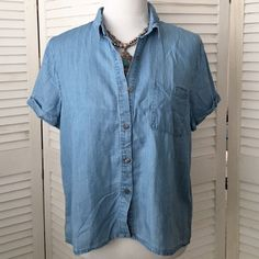 Paper Crane chambray cropped shirt An updated classic! Button front chambray shirt in a cute, slightly cropped length. Collar and cuffed short sleeves. One breast pocket. 100% Tencel. Junior size L. NWT; never worn. Paper Crane Tops Button Down Shirts