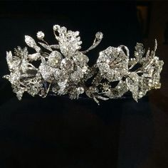 Diamond tiara, set with rose and round cut diamonds and in gold, silver. The big flowers can be removed and used in different ways, fitted case signed Musy, Torino. Property of a noble Italian family.