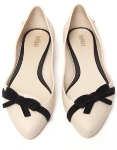 Ivory flats with black bow accent details - give a little pop to your next outfit!
