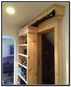 There are basically two types of barn door hardware. The first is a rustic, flat track sliding door system The second is a more modern roller and track style Sliding Door Bookcase, Bookshelf Door, Bookcase With Glass Doors, Sliding Door Hardware, Sliding Barn Door Hardware, Book Shelves, Double Glass Doors, Sliding Glass Door, Sliding Doors