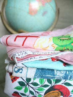 lots of vintage linens - hanging from the dishwasher, stacked on the counter, used as curtains (just hang a little rod and then use clips to hang tea towels as cafe curtains - you can just switch them out as you please!)