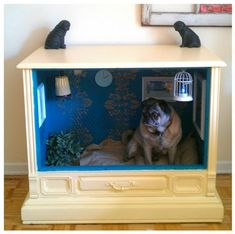 Dog house made out of an old console TV.