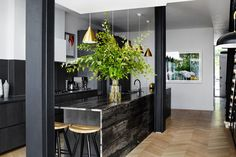 Combining black cabinets with black countertops could feel oppressive, but in this London townhouse designed by Suzy Hoodless, the kitchen feels welcoming and open thanks to warm brass pendant. Townhouse Interior, London Townhouse, Interior Desing, Interior Inspiration, Kitchen Interior, Kitchen Decor, Kitchen Ideas, Kitchen 2016, Gold Kitchen