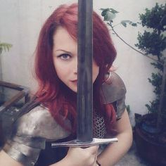 Being defeated is often a temporary condition. Giving up is what makes it permanent. #theredshieldmaiden #sword #warrior #redhead #badass #girl #armor #chainmail #fighter #medieval #myself