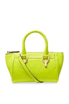 "From DVF, Sutra Mini Duffle Leather Bag In Citrine.  Is Citrine a yellow or a green?  An endless debate in tiny circles of the world.  I am on Team Green. The DVF text is ""Playful and chic, the Sutra Mini Duffle is the perfect weekend bag. With Sutra hardware detail, top zip closure and a detachable shoulder strap.""  It's basically 5"" x 10"" x 5""."