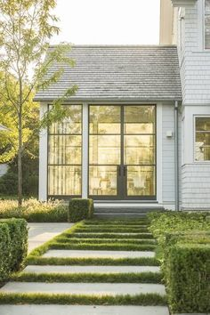 Gorgeous glass panel doors for a sunroom. Love hte blend of traditional and modern style