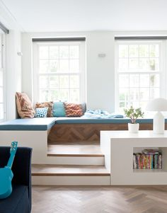 I love the idea of a window seat but probably would paint the walls a light turquoise blue or mint.( I got my son that same color guitar)