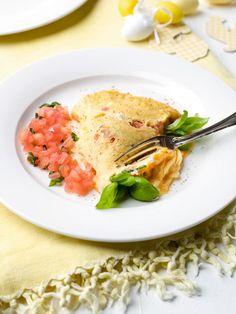 Omelet baveuse met tomaat en basilicum