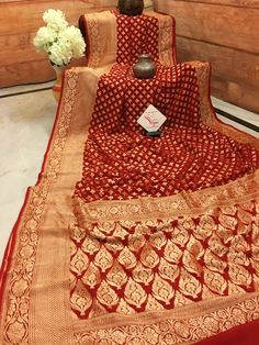 Now make your occasions more sparkling with our latest banarasi saree collections. Like this khaddi Georgette banarasi saree in royal red color and intricate golden zari work. You can bet that it demands a second look any time. Half Saree Designs, Silk Saree Blouse Designs, Bridal Blouse Designs, Indian Bridal Fashion, Indian Bridal Wear, Pink Saree, Red Sari, Red Saree Wedding, Silk Saree Banarasi