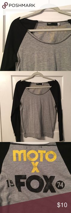 Fox Racing Off Shoulder Top Worn once to a Race, like new condition.  Front is simple grey with black sleeves but the back has the Fox Racing Design, super cute! Fox racing  Tops Tees - Long Sleeve