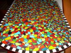 I'm thinking green, white & orange mosaic top for the kitchen table! Perfect!
