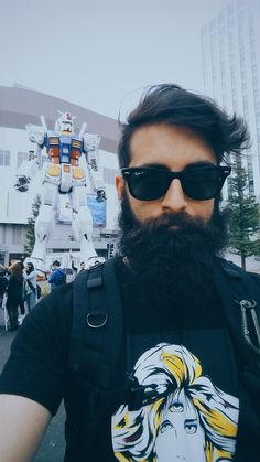 The facial hair and the mobile suit in the background. The best (particularly the latter)! lol