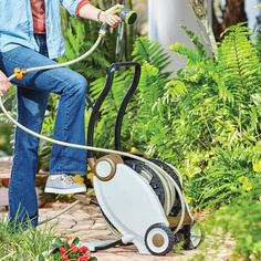 "Forget about struggling to rewind your garden hose! This convenient hose reel uses foot pedal power to easily guide the attached 1/2"" PVC hose back into its coiled position. To make it even easier to use, we have added an auto track that helps guide the hose & makes sure it remains tangle free as it rewinds. To lock the hose in place, just use the clamp provided. And perhaps best of all, when the warm weather season is over, pressing the two side buttons folds the reel in half for easy…"