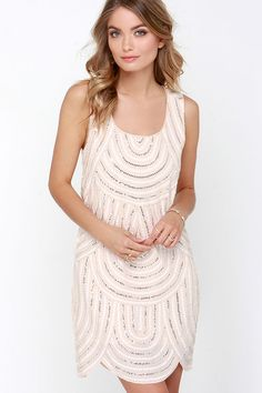 I love the shape of the bottom of this dress. The sparkle makes it perfect for a date night too!