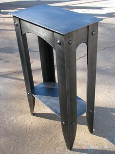 """TABLE"" 2009 Steel - wish the legs were a bit more delicate - 1/2 "" thinner ea. side."