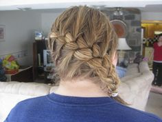 The Katniss Braid! My friend Hillary is a GENIUS at doing hair. I'm not exactly sure how she did it but I will say - if I was Katniss, I would also wear this style to the Hunger Games - cute and practical!