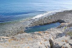 Wild swimming in nature's own bathing pool at Dancing Ledge near Swanage - This Is Your Kingdom