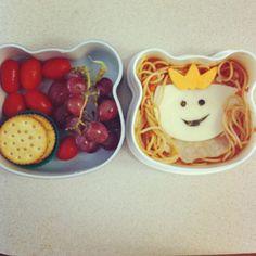 Princess bento: grapes, grape tomatoes, peanut butter crackers, spaghetti, cheese