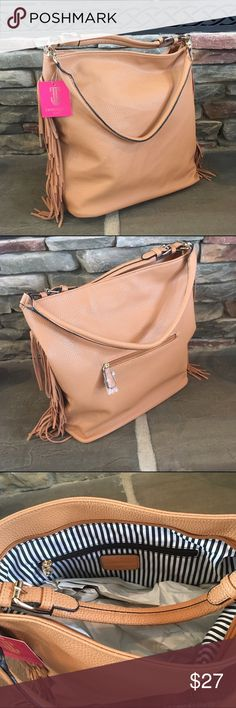 Oversized Boho Fringe Bag Get an instant boho vibe carrying this oversized bag!  It features fringe on both sides, and two different handle options.  The longer handle is detachable.  The inside is lined with a cute black and white silky fabric.  It has one outside zipper pocket, one inside zipper pocket, and two smaller inside pockets.  New with tags!  No content tag present, but I believe it's all man made materials.  It's a textured, faux leather. Expressions NYC Bags Shoulder Bags