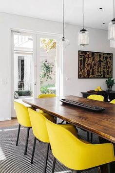 Yellow Chairs...Mid-Century-Modern chairs in a Dining Room. Rustic wood plank table. Kitchen Design.