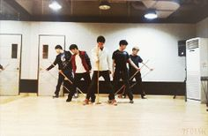 """Managers for SNSD, Super Junior, fx, EXO, & SHINee decided to get together, grab some mops, & do their own cover of """"Dream Girl"""". Of all the choreographies they could have copied they had to go & pick one of the hardest. Each """"dancer"""" is identified by the group they represent. (.gif set)."""