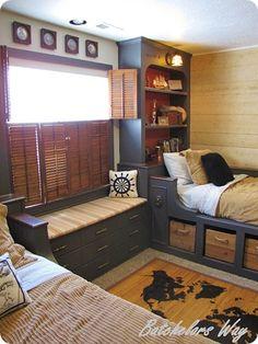 boys bedroom - twin beds with headboard shelving & baskets below - great window seat bench & shutters