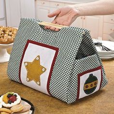 Christmas Casserole Carrier - Party Decorations & Room Decor by Terrys Village. $30.97. Use this festive Christmas Casserole Carrier to carry hot items to your family's holiday feast! This hot food carrier has a green and white checker pattern with red-bordered white patches featuring felt Christmas decorations. Decorations include a gold star with white button accents, a green ornament with a gold band and red button accents, and green Christmas tree with red, wh...