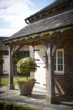 lean to Garden room Green oak lean to. Creating a beautiful sheltered outdoor space. Photography by Andy Haslam. to garden room Porch Extension, Cottage Extension, Porch Shelter, Cottage Porch, Garden Cottage, Curved Pergola, Rustic Pergola, Cedar Pergola, Porch Canopy