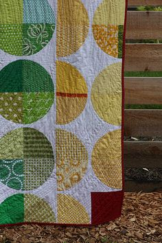 Quilts with yellow, green, red circles
