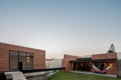 A brick volume containing a games room balances on steel beams that raise it above the sloping plot of this house in the Mexican city of Zapopan. Outdoor Steps, Rest House, Steel Beams, Game Room, My Dream Home, Facade, Brick, Backyard, Exterior