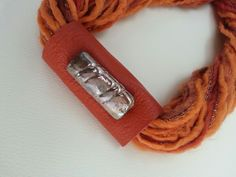 Handmade orange and gold necklace made of wool, leather and raku ceramic bead