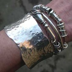 silver expanding bangles being worn with a cuff  http://www.silverandstone.co.uk/html/expanding_bangles.html